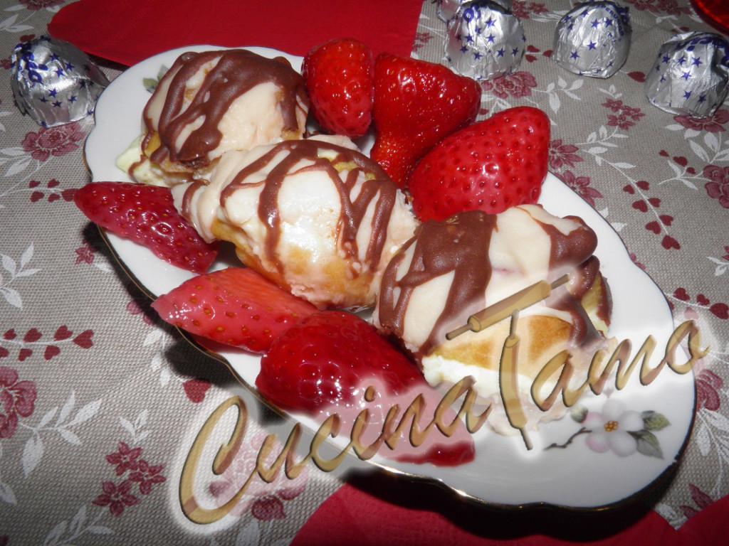 Profiteroles al cioccolato bianco e frutti rossi